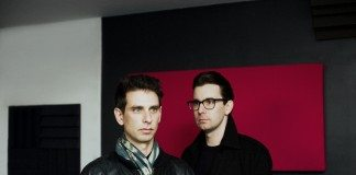 Vito & Druzzi con cuadro rojo