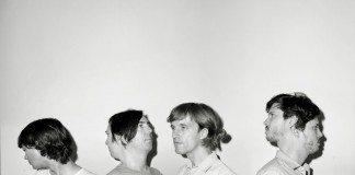 Cut Copy en una foto en blanco y negro con sus caras dobles.